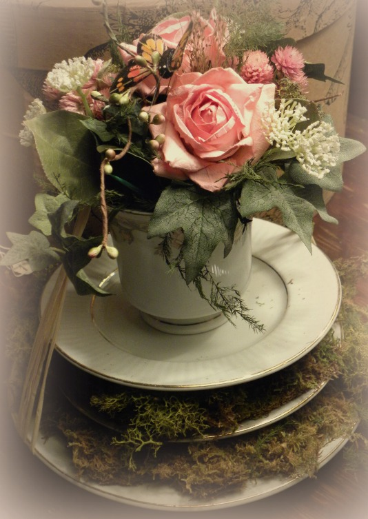 mossy teacup of flowers