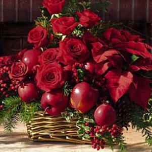 Christmas basket of pointsettia roses and apples