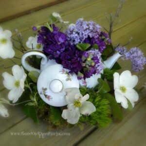 flower arrangement with a teapot